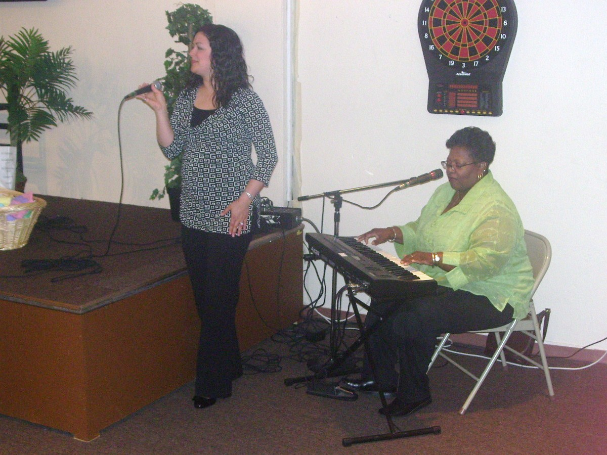 Sis. Sarah Cascone and Rev. Lynn Hill lead Praise & Worship at the first Annual Mother-Daughter Luncheon.